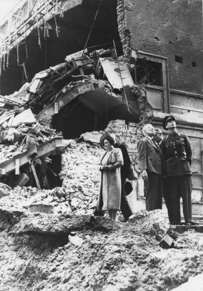 Britain's King George VI (R) and Queen Elizabeth (the Queen Mother)(L) view damage at the cinema attached to Madame Tussaud's on September 19, 1940 during one of their tours of London areas affected by the German bombings. File photo UPI
