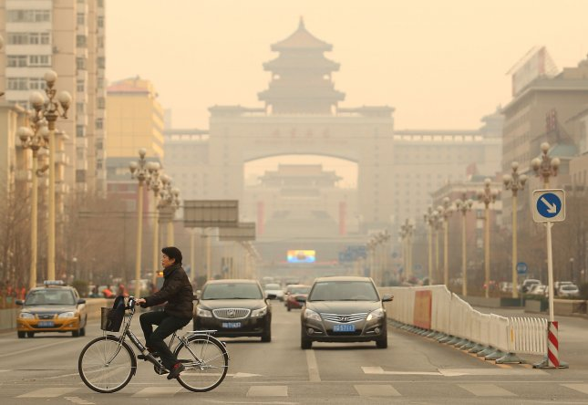 Pollutants in the air from vehicles and the burning of fossil fuels have been linked to brain damage known to lead to other neurological disorders associated with old age, a new study finds. Photo by Stephen Shaver/UPI.