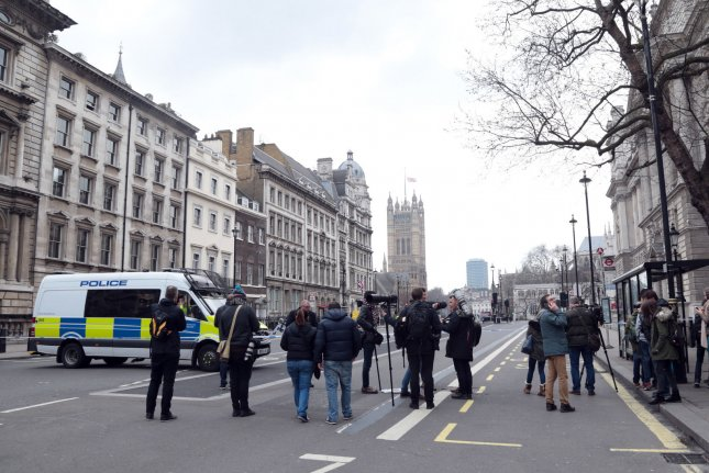 Metropolitan Police patrol near Westminster Palace Thursday after the terrorist attack outside the Houses of Parliament on Wednesday killed four victims and injured nearly 30 others. Photo by Hugo Philpott/UPI