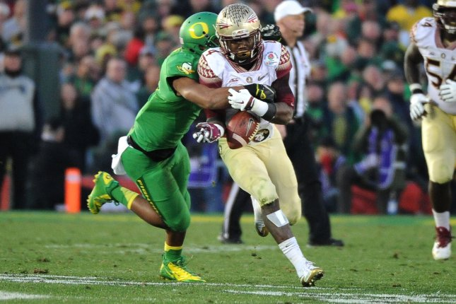 Florida State Seminoles running back Dalvin Cook (4) is stripped of the ball by Oregon Ducks defensive back Erick Durgan during the third quarter of the Rose Bowl in Pasadena, California on January 1, 2015. Cook is projected to be the first pick by the Packers in the 2017 NFL Draft. File photo by Jon SooHoo/UPI