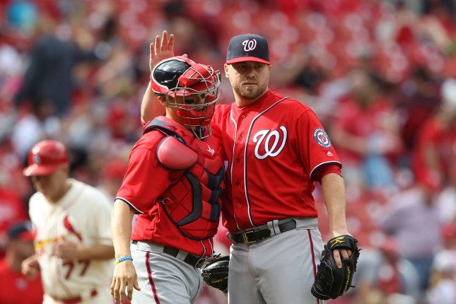 Washington Nationals pitcher Shawn Kelley congratulates catcher Jose Lobaton after the third out and a 6-1 win over the St. Louis Cardinals at Busch Stadium. File photo by Bill Greenblatt/UPI