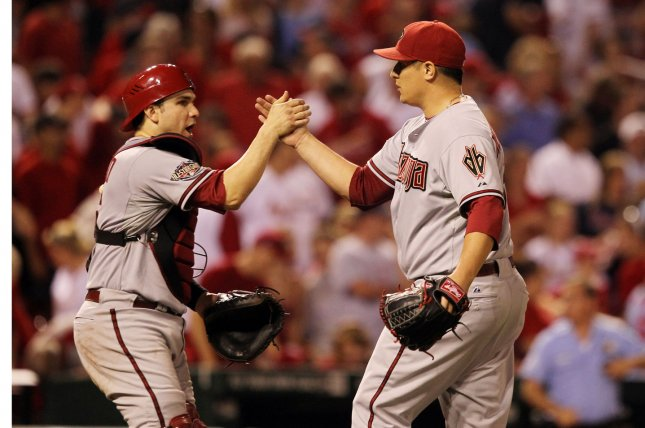 Arizona Diamondbacks pitcher David Hernandez (R) celebrates the third out and a 7-6 win over the St. Louis Cardinals with former catcher Miguel Montero at Busch Stadium in St. Louis on July 8, 2011. File photo by Bill Greenblatt/UPI