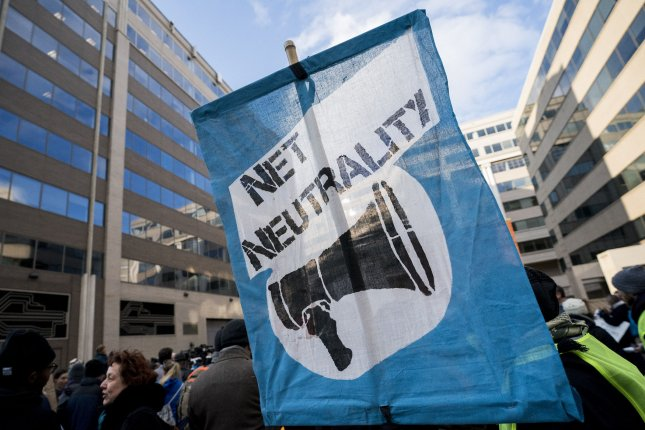 A protesters sign is seen during a rally against the Federal Communication Commission's (FCC) Chairman Ajit Pai's proposal to repeal 'net neutrality' rules. Photo by Kevin Dietsch/UPI