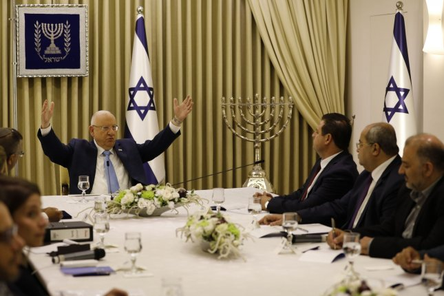Israeli President Reuven Rivlin speaks with members of the Joint List -- Ayman Odeh (3rd-R), Ahmad Tibi (2nd-R) and Mansour Abbas (R) -- during a consulting meeting in Jerusalem on Sunday to decide who to task with trying to form a new government. Pool photo by Menahem Kahana/UPI