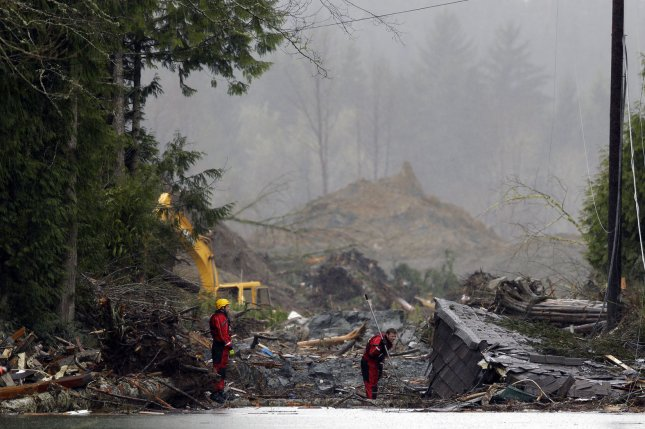 Search and rescue personnel work in the debris field on March 27, 2014, in Oso, Wash., five days after a mudslide killed 43 people. File Photo by Ted Warren/Pool