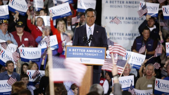 Republican presidential candidate Mitt Romney pauses as the crowd cheers for him during a speech at the Radisson in Manchester, New Hampshire on April 24, 2012. UPI/Matthew Healey