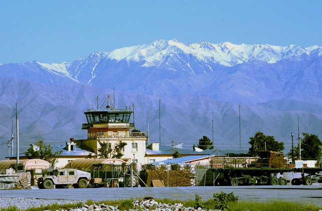 The Bagram Air Base is nestled in the shadow of the Hindu Kush Mountain range where the snow-capped peaks can be clearly seen on April 26, 2004. (UPI Photo/J.G. Buzanowski/Air Force)