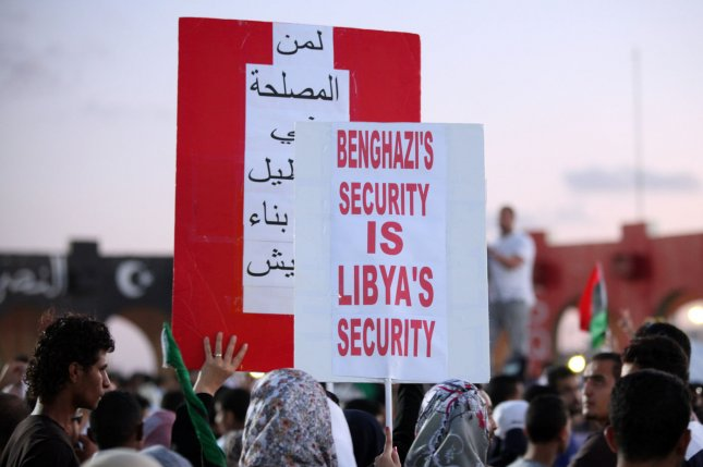 Instability and violence has rocked Benghazi. On December 5, 2013 an American teacher was shot and killed outside his home in Benghazi. Protestors, pictured here, in Benghazi in September 2012, carried a sign that read Benghazi's security is Libya's security. (UPI/Tariq AL-hun).