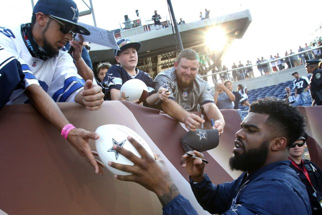 Dallas Cowboy Ezekiel Elliott signs autographs prior to the Cowboys game against the Arizona Cardinals in the Pro Football Hall of Fame Game at Tom Benson Hall of Fame Stadium in Canton OH August 3, 2017. Photo by Aaron Josefczyk/UPI
