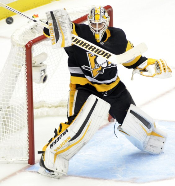 Pittsburgh Penguins goalie Matt Murray bats the puck away during a game against the St. Louis Blues in October. Photo by Archie Carpenter/UPI