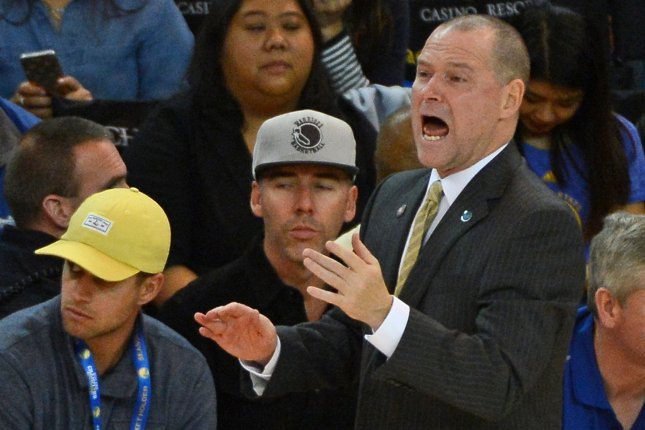 Denver Nuggets head coach Michael Malone calls out instructions in the third period against the Golden State Warriors on November 6, 2015 at Oracle Arena in Oakland, California. File photo by Terry Schmitt/UPI
