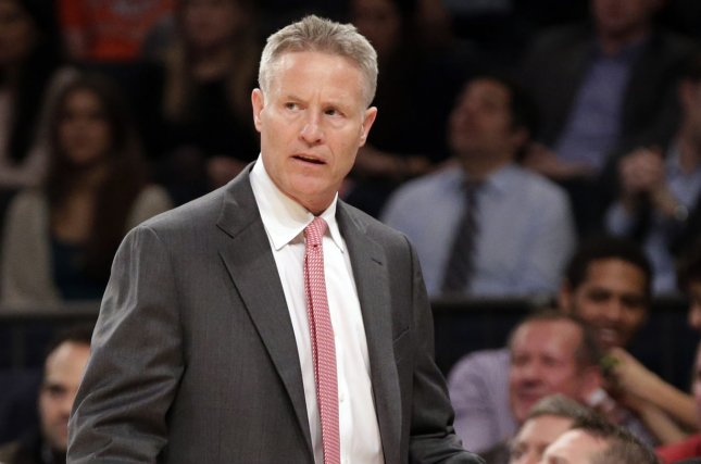Philadelphia 76ers head coach Brett Brown stands on the court in the first half against the New York Knicks on March 10, 2014 at Madison Square Garden in New York City. File photo by John Angelillo/UPI