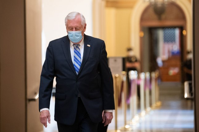House Democratic leader Steny Hoyer is seen Thursday walking to the House Speaker's office at the U.S. Capitol while wearing a face mask. Photo by Kevin Dietsch/UPI