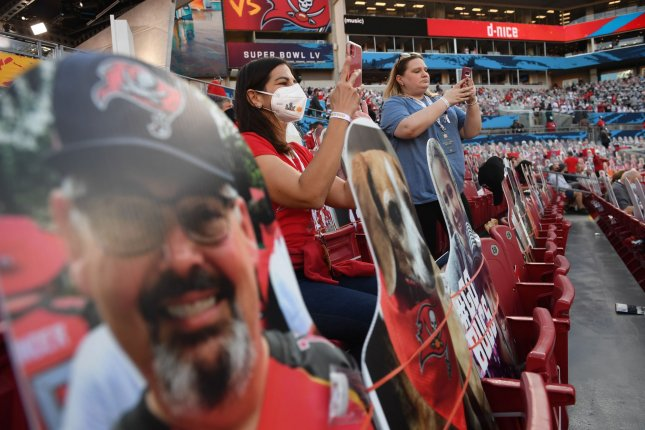 Fans take pictures in the midst of cardboard cutouts due to COVID regulations before the start of Super Bowl LV in Tampa, Fl., on February 7, 2021. File Photo by Kevin Dietsch/UPI