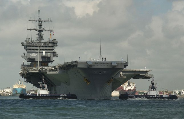 The USS Enterprise passes by the jetty at Port Everglades in Ft. Lauderdale as spectators look on April 30, 2004. The Enterprise had arrived on April 26 to participate in Fleet Week USA, a part of the McDonalds Air and Sea Show,saluting America's military. (UPI Photo/Marino/Cantrell)