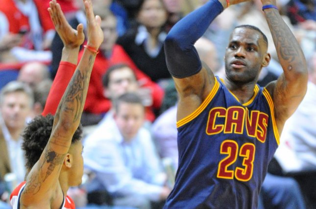 Cleveland Cavaliers forward LeBron James (23) shoots and scores against Washington Wizards forward Kelly Oubre Jr. (12) in the first half at the Verizon Center in Washington, D.C. on January 6, 2016. Photo by Mark Goldman/UPI