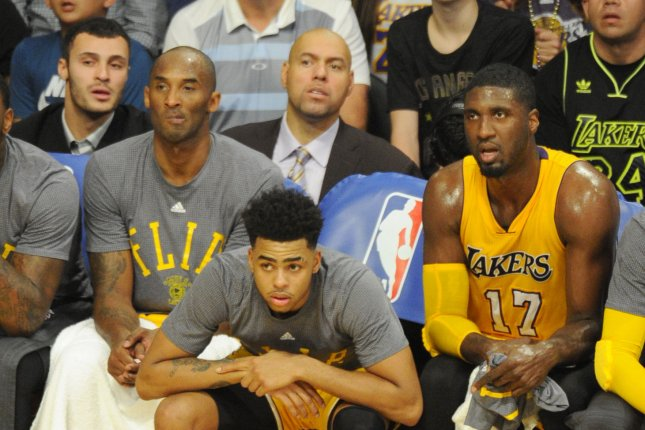 Los Angeles Lakers' guard D'Angelo Russell sits between Kobe Bryant and Roy Hibbert on the Lakers' bench on October 28, 2015. File photo by Lori Shepler/UPI