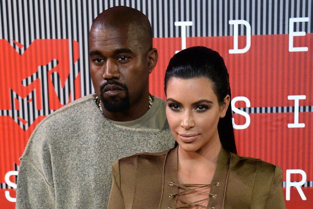 Rapper Kanye West and TV personality Kim Kardashian arrive on the red carpet for the 32nd annual MTV Video Music Awards at Microsoft Theater in Los Angeles on August 30, 2015. West has surpassed Michael Jackson on the list of most Top 40 hits. File Photo by Jim Ruymen/UPI