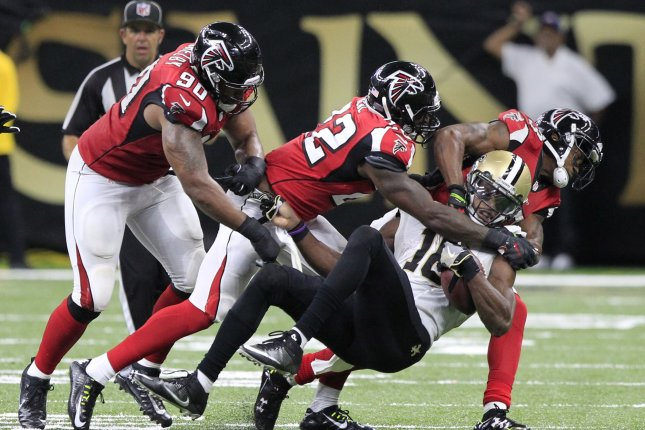 New Orleans Saints wide receiver Brandon Coleman (16) is gang tackled by Atlanta Falcons defenders after a 7 yard gain in the third quarter at the Mercedes-Benz Superdome in New Orleans September 26, 2016. Photo by AJ Sisco/UPI
