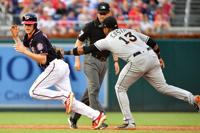 Washington Nationals shortstop Trea Turner is tagged out by Miami Marlins second baseman Starlin Castro (13) in the third inning on July 6 at Nationals Park in Washington, D.C. Photo by Kevin Dietsch/UPI