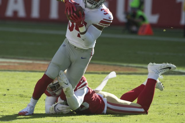 Former New York Giants running back Shane Vereen (34) takes a pass from quarterback Eli Manning seven yards before being tackled by ex-San Francisco 49ers linebacker Reuben Foster in the first quarter on November 12, 2017 at Levi's Stadium in Santa Clara, California. File photo by Terry Schmitt/UPI