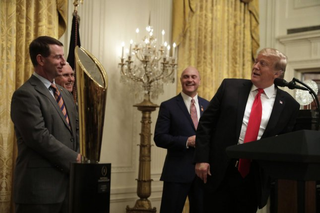 U.S. President Donald Trump speaks to head football coach Dabo Swinney (L) as he welcomes the 2018 College Football Playoff National Champion Clemson Tigers to the White House on Monday in Washington, D.C. Photo by Yuri Gripas/UPI