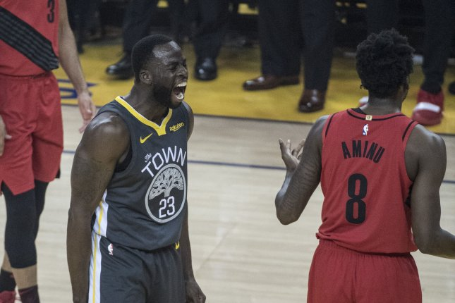 Golden State Warriors forward Draymond Green (23) yells at Portland Trail Blazers forward Al-Farouq Aminu (8) after being fouled on a shot in the first half of Game 2 of the Western Conference Finals on Thursday night in Oakland, California. Photo by Terry Schmitt/UPI