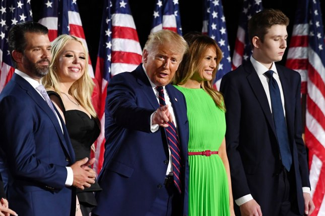 President Donald Trump (C) stands with family members, from left to right, son Donald Trump Jr., daughter Tiffany Trump, first lady Melania Trump and son Barron Trump after speaking on the final night of the Republican National Convention. Photo by Kevin Dietsch/UPI