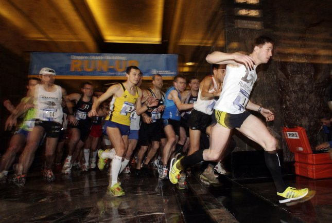 Thomas Dold (R) of Germany takes the lead as competitors break away from the start line and rush to the stairs to climb to the top of the Empire State Building at the New York Road Runners 33rd Annual Empire State Building Run-Up at the Empire State Building in New York City on February 1, 2011. Thomas Dold wins his 6th consecutive Empire State Building Run-Up. UPI/John Angelillo