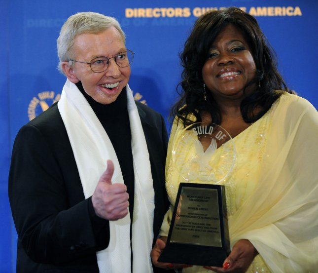 Film critic Roger Ebert appears backstage with his wife Judge Chaz Hammelsmith after receiving the Honorary Life Membership Award at the 61st annual Directors Guild of America Awards in Los Angeles on January 31, 2009. (UPI Photo/Jim Ruymen)