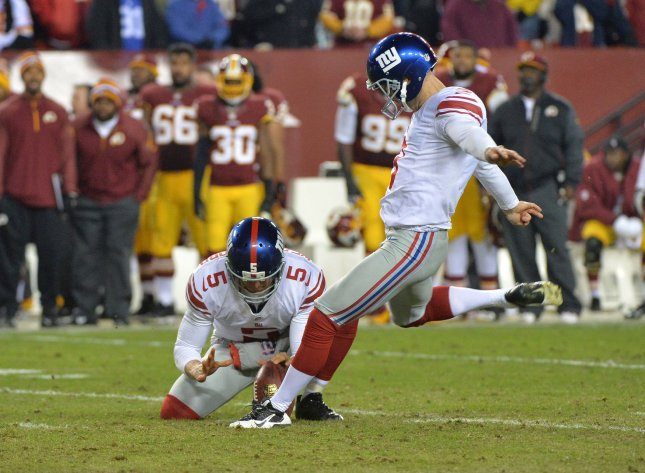New York Giants kicker Josh Brown is not traveling with the team as an investigation looks into domestic abuse allegations. His coach is standing behind him. File photo by Kevin Dietsch/UPI