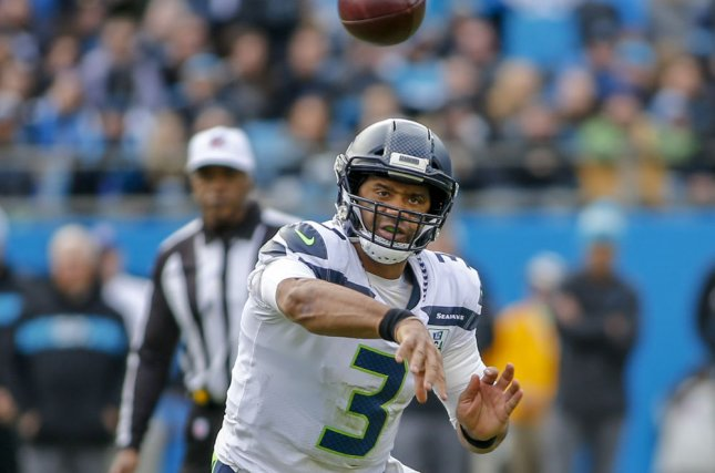 Seattle Seahawks quarterback Russell Wilson (3) passes against the Carolina Panthers in the second half on November 25, 2018 in Charlotte, North Carolina. Photo by Nell Redmond/UPI