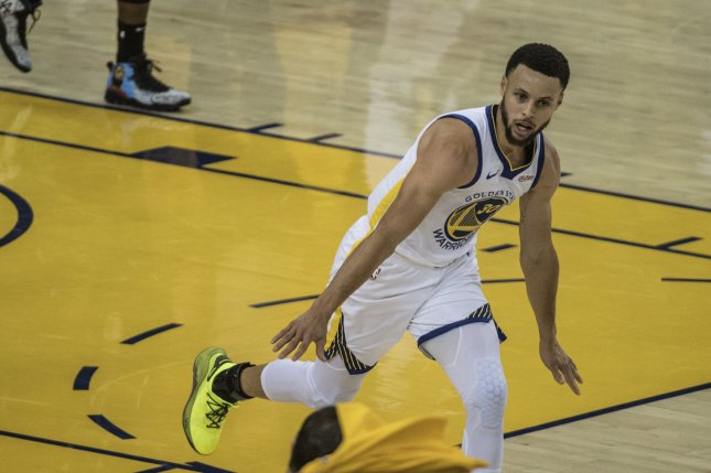 Golden State Warriors guard Stephen Curry (30), shown on April 13, 2019, surpassed Wilt Chamberlain's scoring mark during Monday's game against the Denver Nuggets. File Photo by Terry Schmitt/UPI