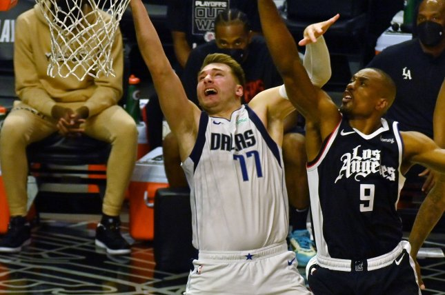 Los Angeles Clippers big man Serge Ibaka (R), shown May 22, 2021, played in the Clippers' first two playoff games against the Dallas Mavericks but had missed the last seven games. File Photo by Jim Ruymen/UPI