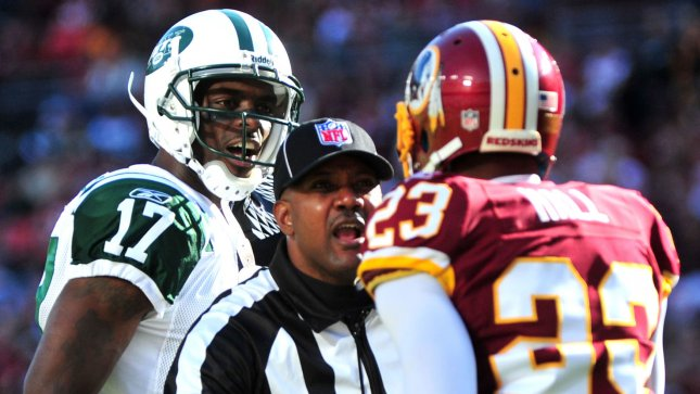 New York Jets wide receiver Plaxico Burress gets into a showing match with Washington Redskins corner back DeAngelo Hall during the first period at FedEx Field in Landover, Maryland on December 4, 2011. UPI/Kevin Dietsch