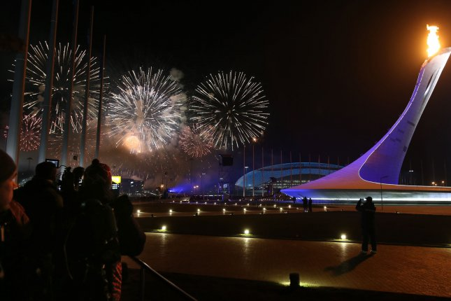 Spectators watch as fireworks light the sky after the lighting of the Olympic torch marking the opening of the 2014 Winter Olympic Games on February 7, 2014 in Sochi, Russia. UPI/Maya Vidon-White