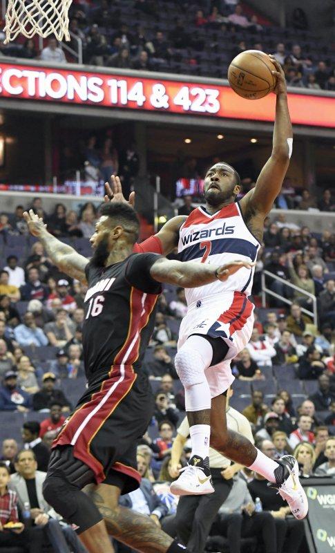 Washington Wizards guard John Wall (2) scores on a fast break against Miami Heat forward James Johnson (16) in the first half at the Verizon Center in Washington, D.C. on April 8, 2017. Photo by Mark Goldman/UPI