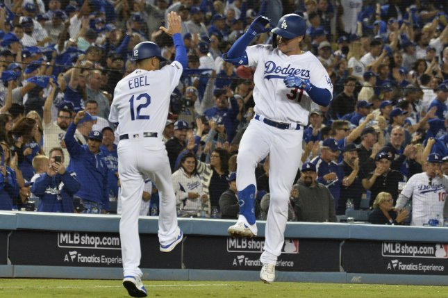 Los Angeles Dodgers slugger Joc Pederson (R) celebrates with third base coach Dino Ebel after hitting a solo home run in the eighth inning of the MLB National League Division Series against the Washington Nationals on Thursday at Dodger Stadium in Los Angeles. Photo by Jim Ruymen/UPI