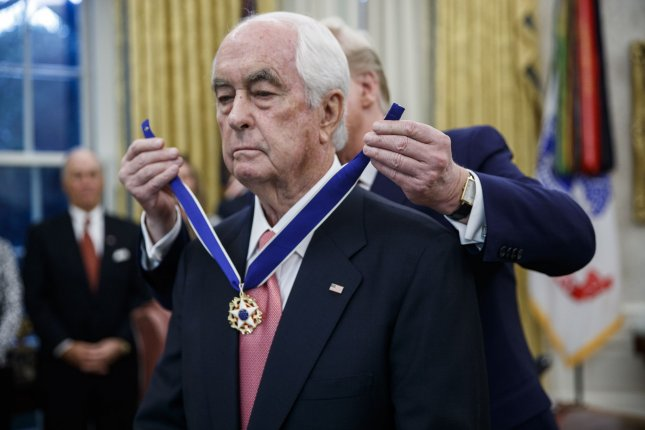 President Donald Trump awards the Presidential Medal of Freedom to American racing magnate Roger Penske. Photo by Shawn Thew/UPI
