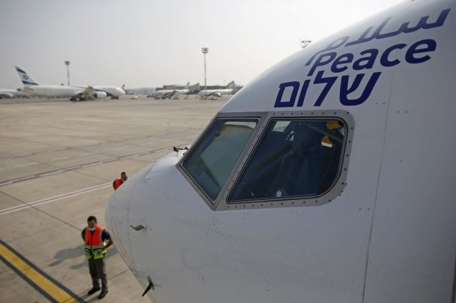 The Arabic, English and Hebrew words for peace are seen Monday on the inaugural El Al flight to Abu Dhabi, United Arab Emirates, at Ben Gurion Airport near Tel Aviv, Israel. Photo by Nir Elias/UPI/Pool