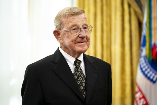 Former college football coach Lou Holtz is presented the Presidential Medal of Freedom on December 3 in the Oval Office at the White House. He turns 84 on January 6. File photo by Doug Mills/UPI