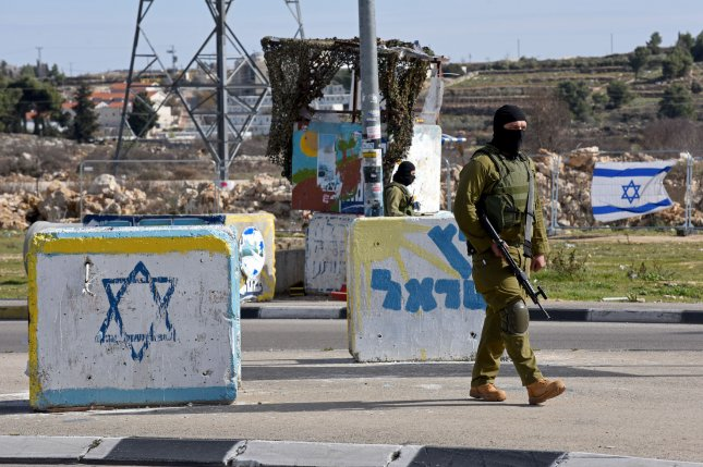An Israeli soldier from the elite infantry unit stands guard at the Gush Etzion Junction in the West Bank on the road between Jerusalem and Hebron, January 5, 2016. Photo by Debbie Hill/ UPI