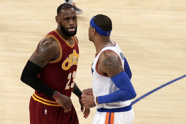 Cleveland Cavaliers' LeBron James stands with his tongue out near New York Knicks' Carmelo Anthony at Madison Square Garden in New York City on December 7, 2016. The Cavaliers defeated the Knicks 126 to 94. Photo by John Angelillo/UPI