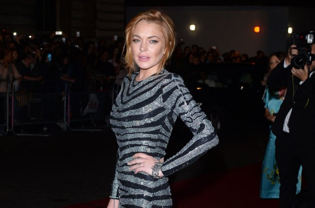 American actress Lindsay Lohan attends the GQ Men of the Year Awards in London on September 3, 2014. Lohan is to co-star in the British series Sick Note. File Photo by Rune Hellestad/UPI
