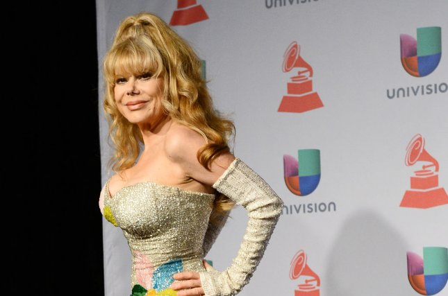 The 68-year old daughter of father (?) and mother(?) Charo in 2019 photo. Charo earned a  million dollar salary - leaving the net worth at  million in 2019