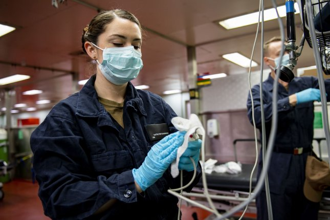 Katelynn Kavanagh of the U.S. Navy sanitizes medical equipment aboard the Military Sealift Command hospital ship USNS Mercy on Tuesday. Photo by MC2 Ryan M. Breeden/U.S. Navy