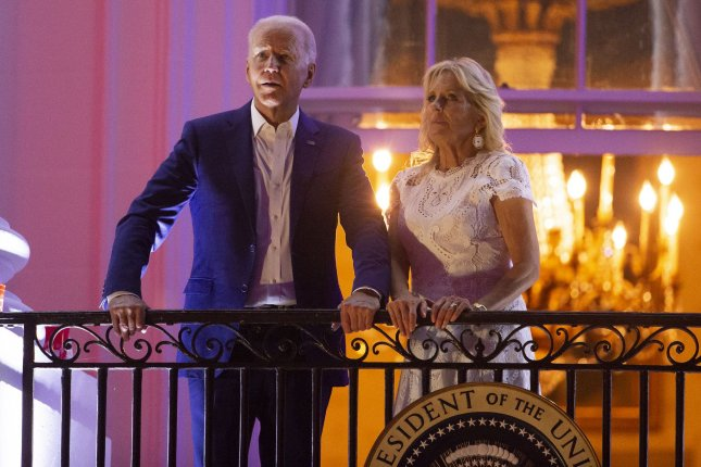 President Joe Biden and first lady Jill Biden watch fireworks on the National Mall from the Truman balcony of the White House in Washington, D.C., on July 4. Photo by Michael Reynolds/UPI
