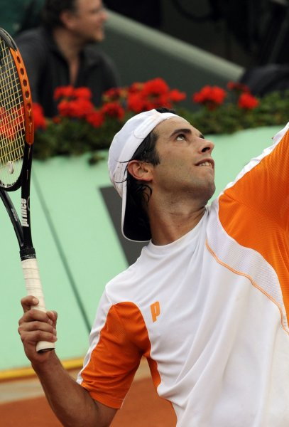 Spaniard Albert Montanes serves at the French Open May 29, 2008.(UPI Photo/Eco Clement)