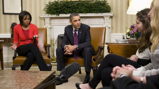 First lady Michelle Obama, U.S. President Barack Obama, and Sarah and Emily Buder of Mills Valley, CA, (L to R) chat in the Oval Office during the White House Conference on Bullying Prevention in Washington on March 10, 2011. UPI/Shawn Thew/POOL