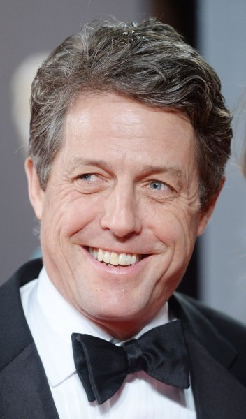 English actor Hugh Grant attends the 70th EE British Academy Film Awards in London on February 12. Grant will soon be seen in a brief followup to his classic romantic comedy Love Actually. File Photo by Paul Treadway/ UPI